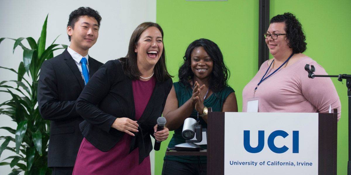 UCI alumna Erin Gruwell (second from left), keynote speaker at the OC Working Together summit, was joined on stage by her Freedom Writers students.
